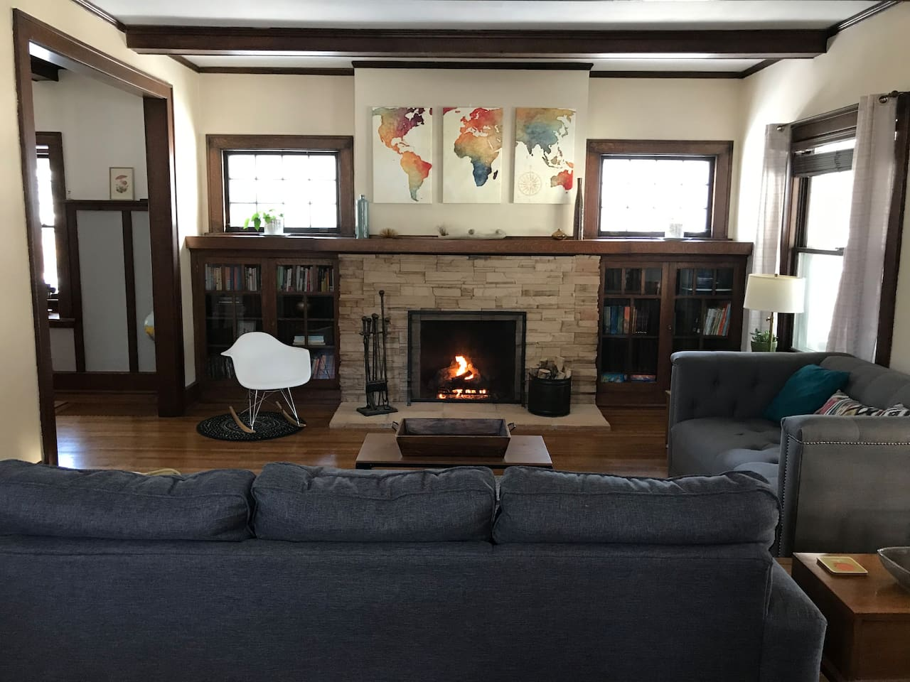 "Formal living room with gas fireplace and ""Free Little Library"" for guests."