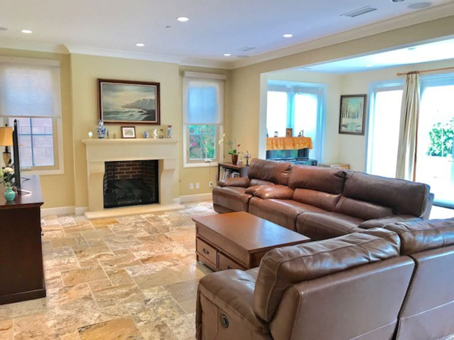 Spacious living room/great room with piano conservatory room