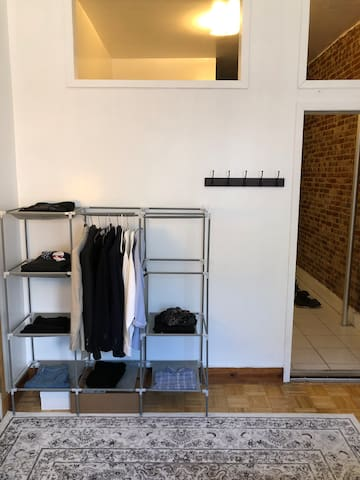 Clothing rack. Note: all personal items will be stored and out of sight. Hangers will be provided.