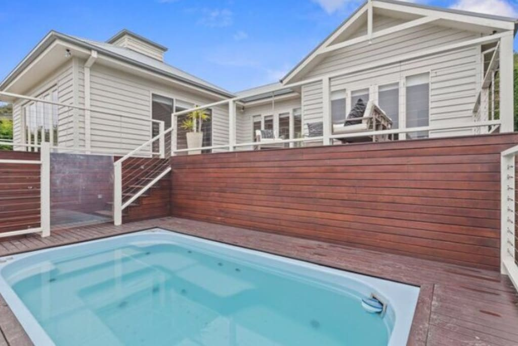 Front of the house with decking and large spa