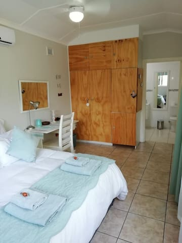 Bedroom 1:  with queen size bed, work station, ample cupboard space  and full en-suite bathroom.