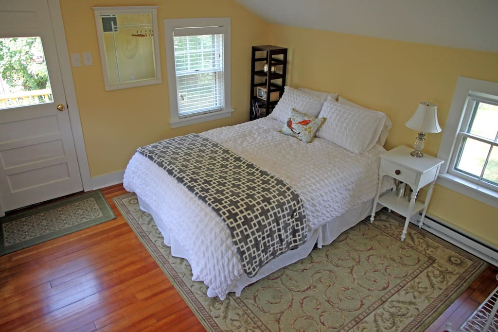 Queen-size bed. Entrance to left