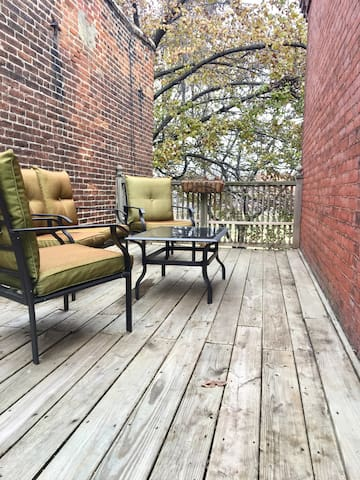 Spacious deck overlooking the brewery.