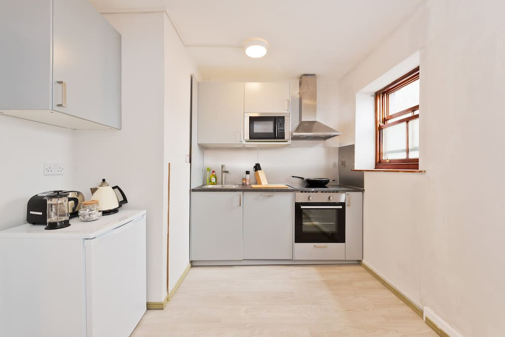 Fully equipped kitchen with all cooking essentials supplied