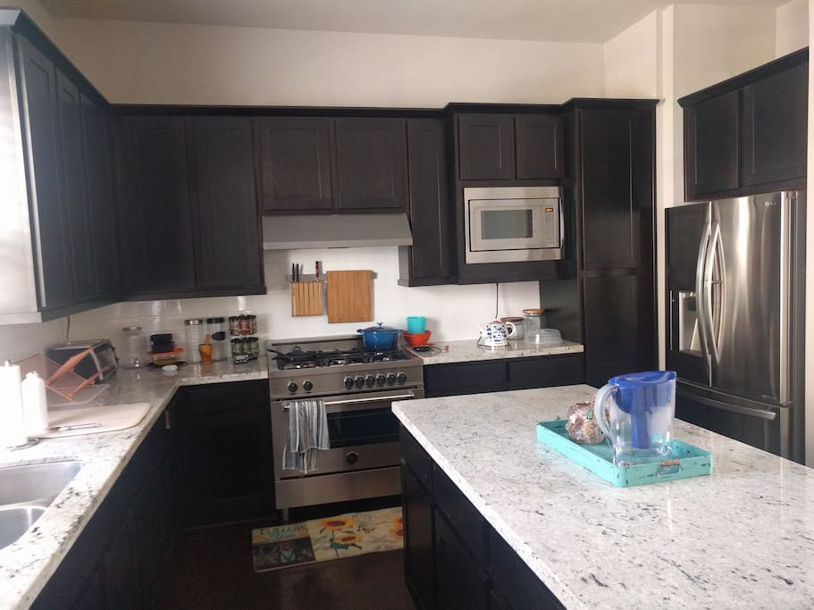 The full shared kitchen. All utensils, appliances, and cookware are available for use. Just be sure to clean up after yourself! :)