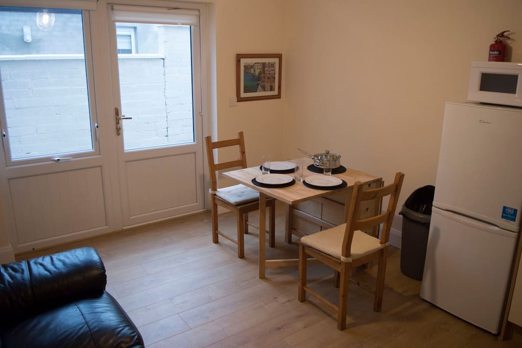 The dinning/kitchen area is cool and clean for you to enjoy any meal while here in Dublin