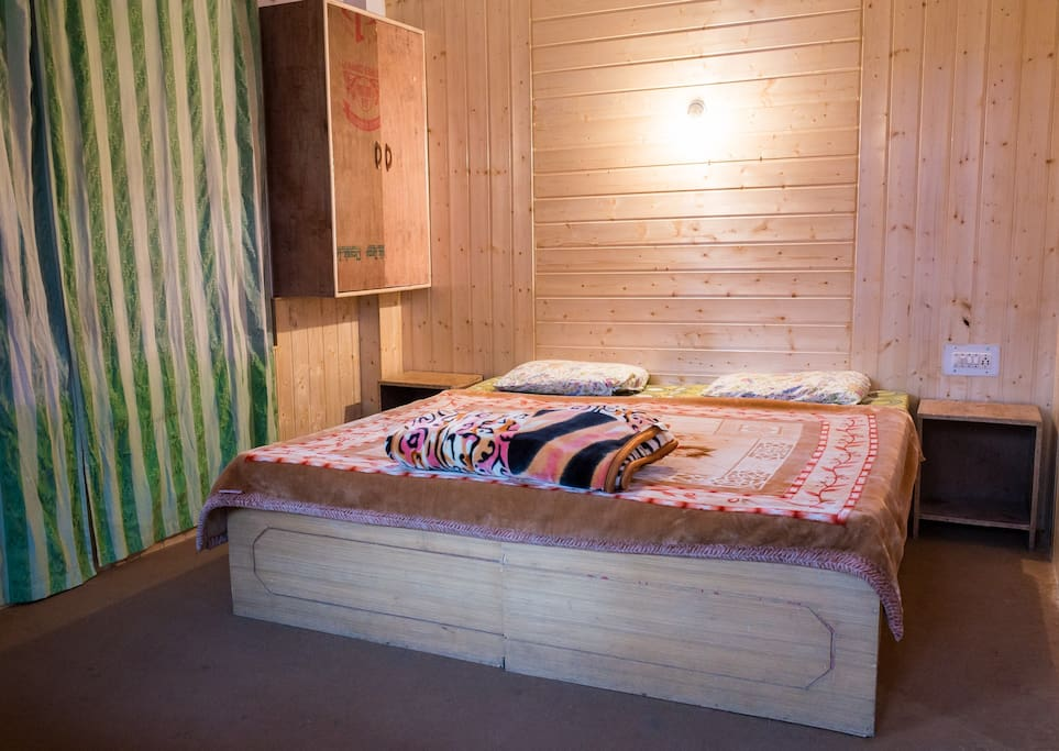 Cozy room with big double bed and pinewood finish