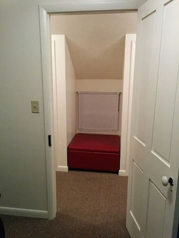 Nice leather window seat with secret storage.  This is looking out from Middle bedroom - large closet on either side of window.