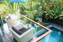 Second floor master bedroom balcony overlooking pool and gardens.