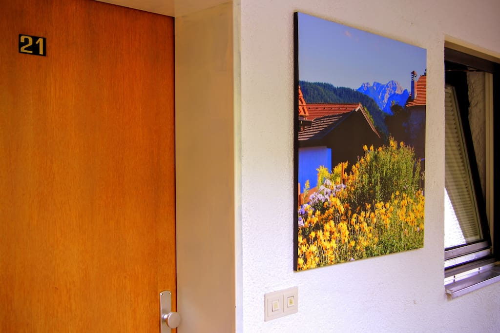 Hallway art and entrance door to apartment