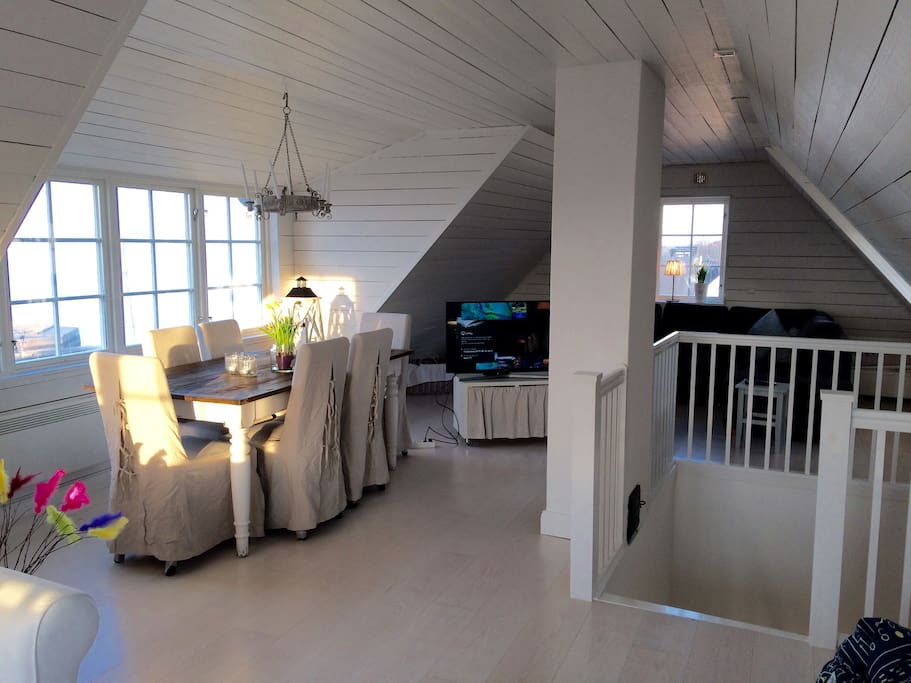 Large living room upstairs with ocean view