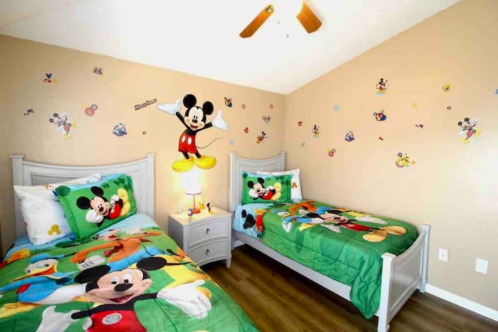 Bedroom# 2: Disney Bedroom located on the second floor featuring TWO twin beds on premium vinyl laminate floor, finished with ceiling light/fan