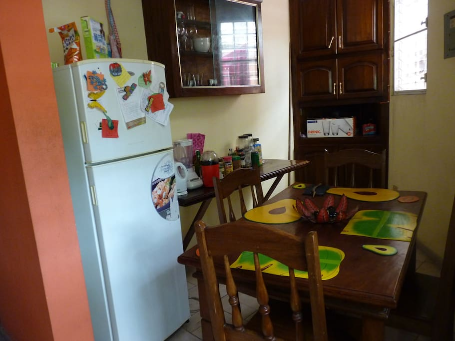 Our kitchen with fridge, popcorn maker, kettle, blender and dining table