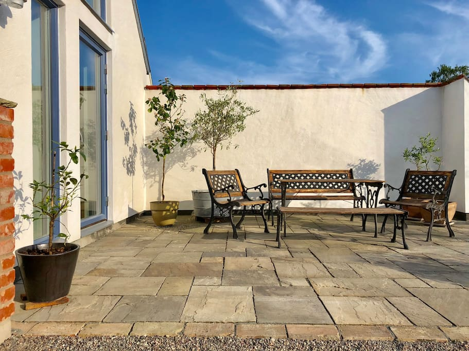 Stone patio facing southwest - great for relaxing in the afternoon and evening