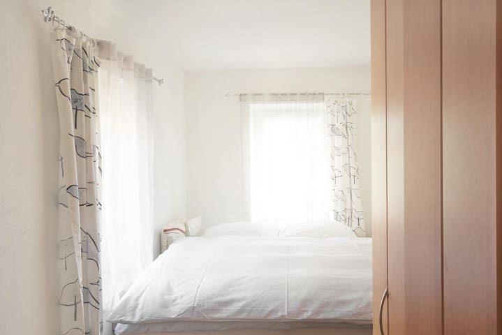 second bedroom with a large bed for 2 persons
