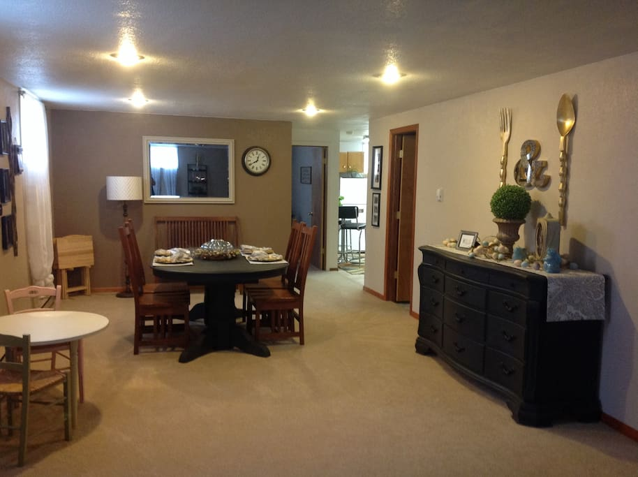 Dining space or game table or computer table. Game Center dresser. Doors leading off to second bedroom, bathroom and kitchen area
