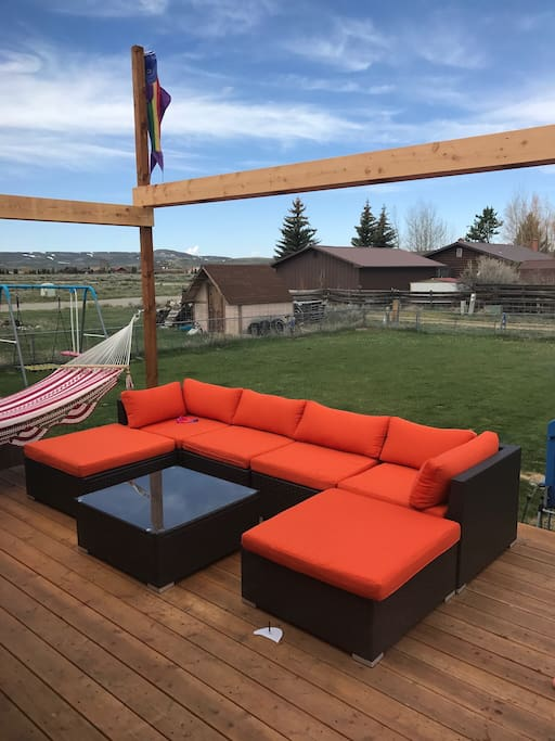 Hot tub, grill, hammock and sectional couch. Can be arranged for outdoor sleeping.