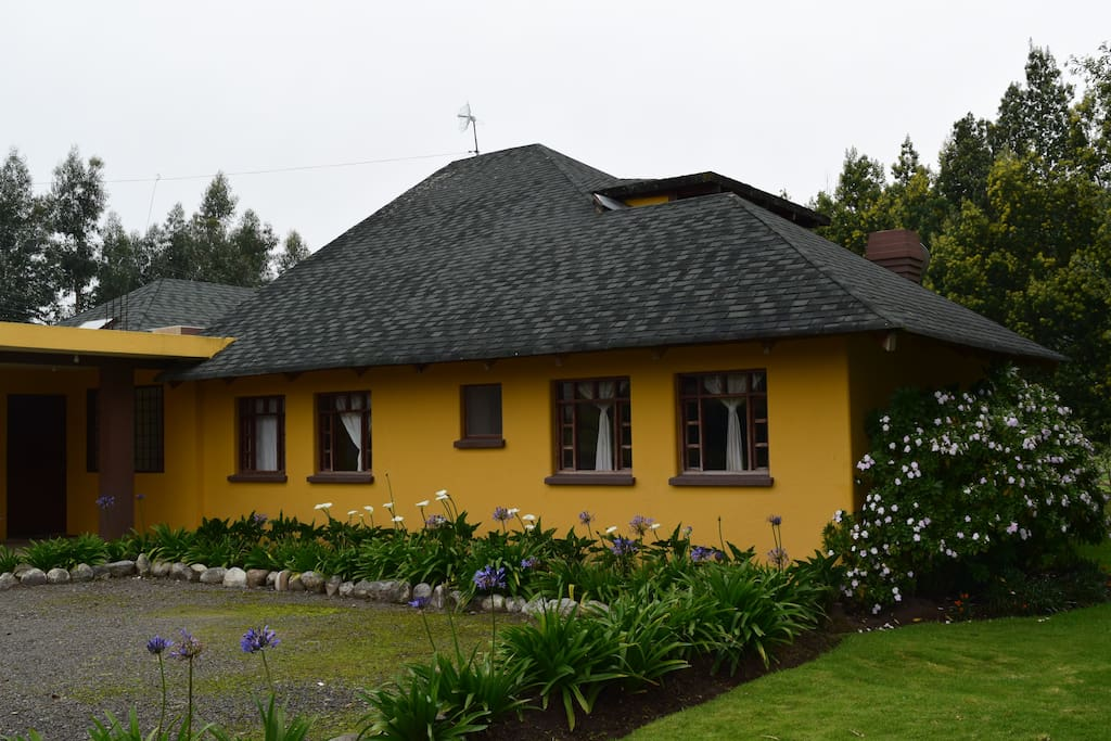 Back of the house with parking place