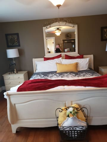 King sleigh bed in master bedroom has a private full bath and very large walk in closet