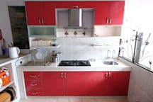Our kitchen, clean and tidy... All cooking appliances like wok, frying pan, electric kettle etc are available here