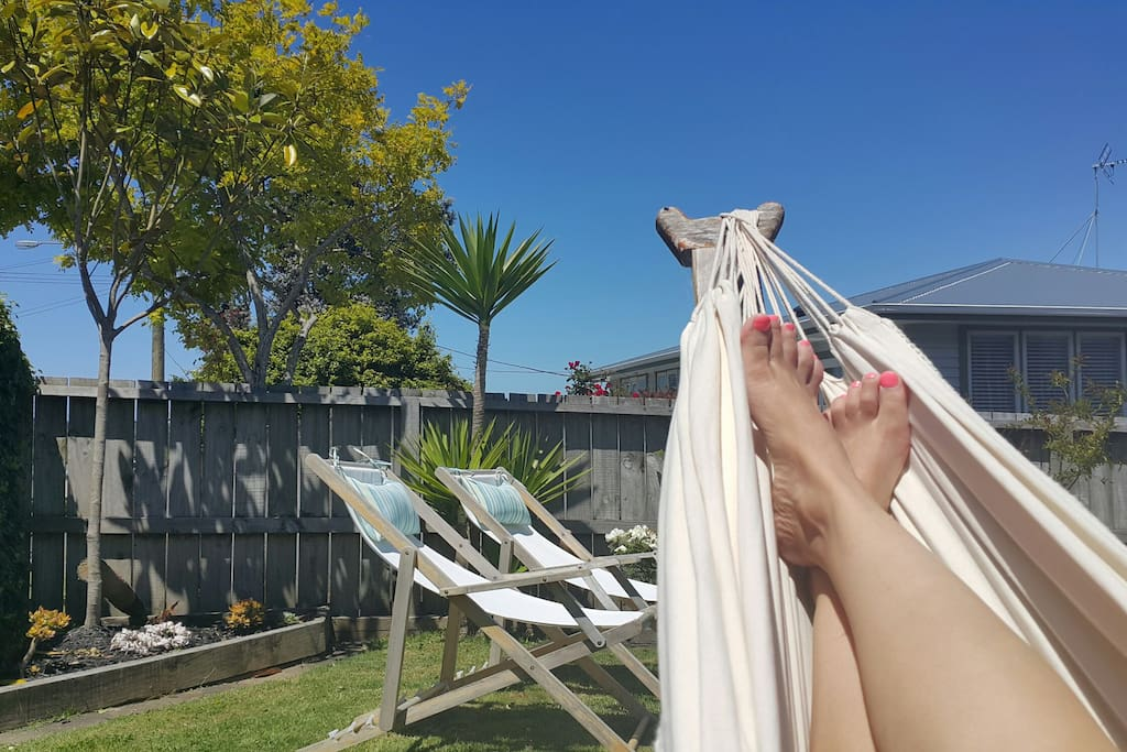 Lovely and sunny outdoors. Sunny deck, deck chairs and hammock to relax.