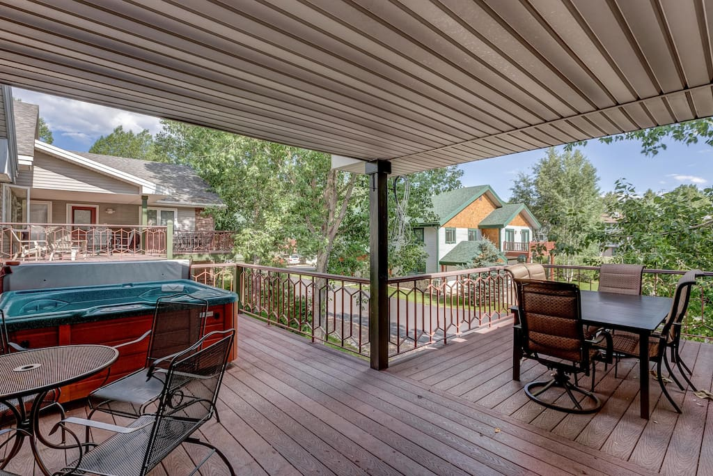 This spacious deck affords you a view of the surrounding trees and includes a large dining space.