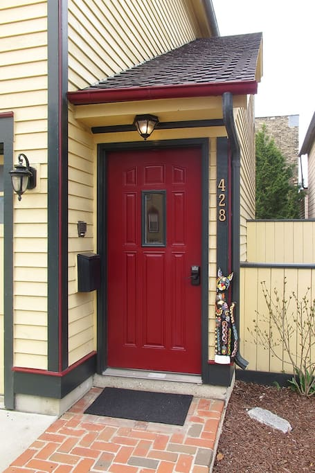 Look for the red door and painted cat at 428.