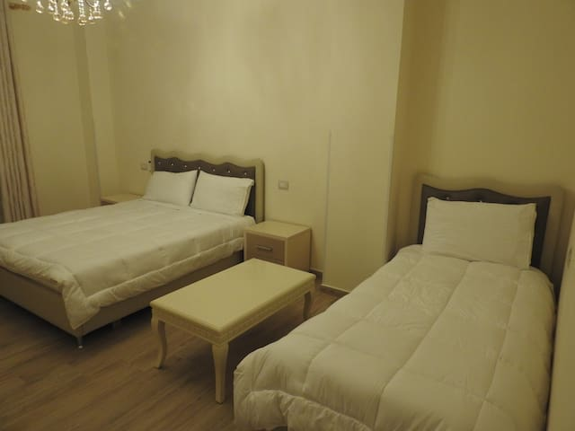 Room with sea view for 3 persons, bathroom, smart TV, air conditioning, fridge, free wifi, wardrobes and balcony