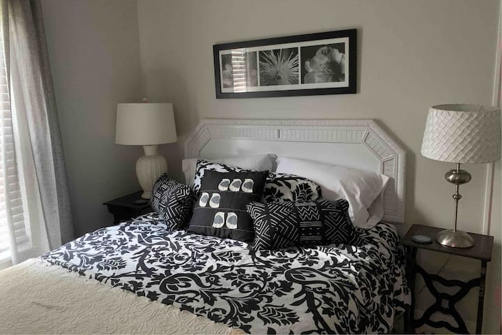 Room darkening drapes will ensure a good night's sleep on this queen size pillow top mattress.