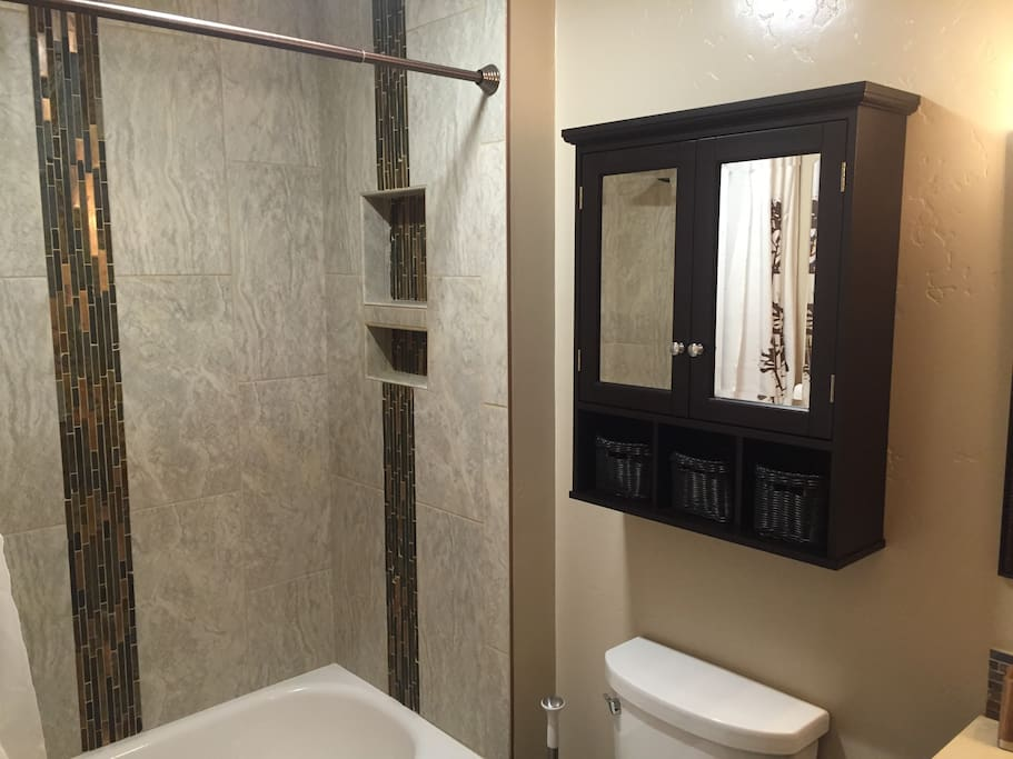 Bathroom with tile shower walls.
