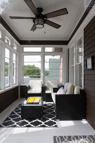 The outdoor fan will keep you cool while you enjoy the front porch.