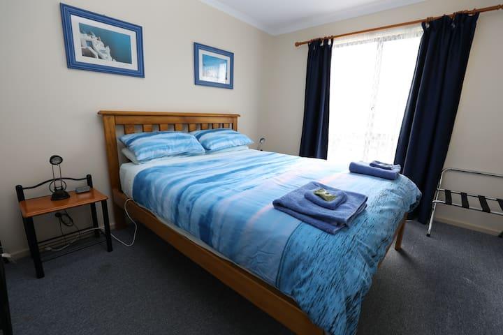 Bedroom #2 with queen bed, dual electric blanket, suitcase rack & garment rack