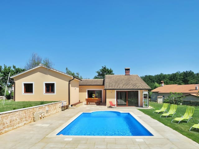 Holiday home with pool and relaxing garden in a peaceful rural area