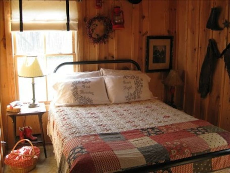 Cuddle up in the cowboy room. The cabin offers 2 bedrooms each with a queen.