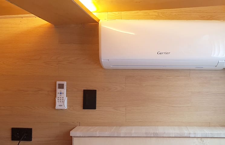 Air-conditioner for cooling & heating in the attic.