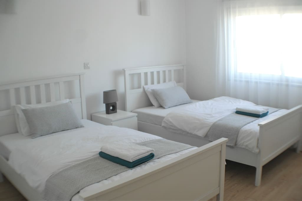 Second bedroom with twin beds, fresh linen and towels