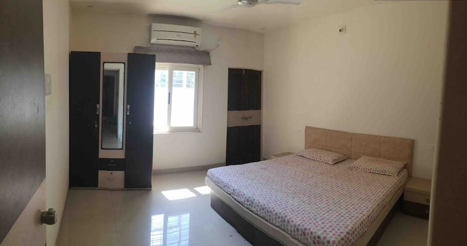 From left Master Bedroom with cabinet, mirror, window with drapers, A.C, door to the bedroom balcony with metal grill & finally double bed as described.