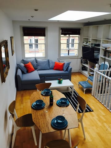 View from roof terrace steps down to living and dining area. Corner sofa converts to a double bed. Huge TV with all the usual channels.