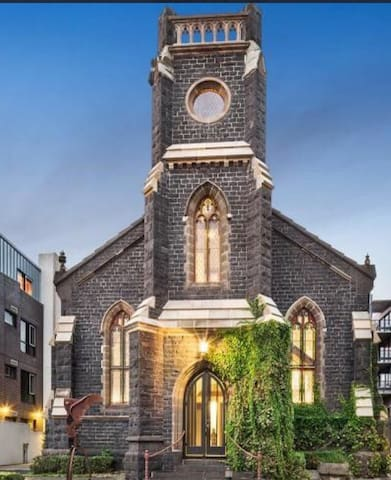 Grand St Kilda Church House. Are you ready to explore? Wind your way up the stairs to the turret. Enjoy plush bedrooms and open living spaces!