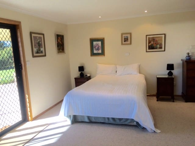 Master Bedroom - Queen size bed and walk in robe, with ample private space to relax.