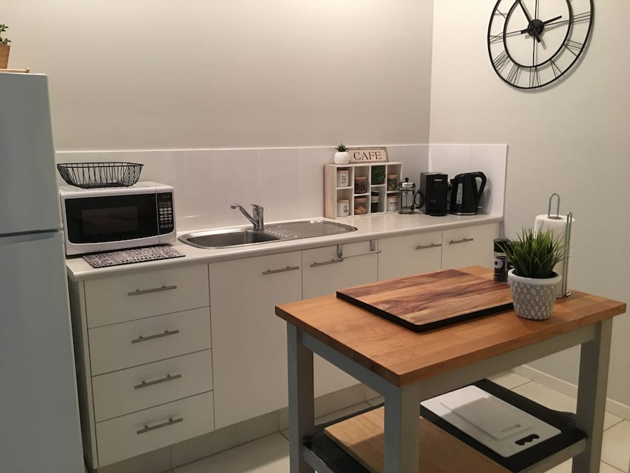 Our kitchen island can be moved to the Centre of the kitchen. Light cooking only but everything you need just the same.