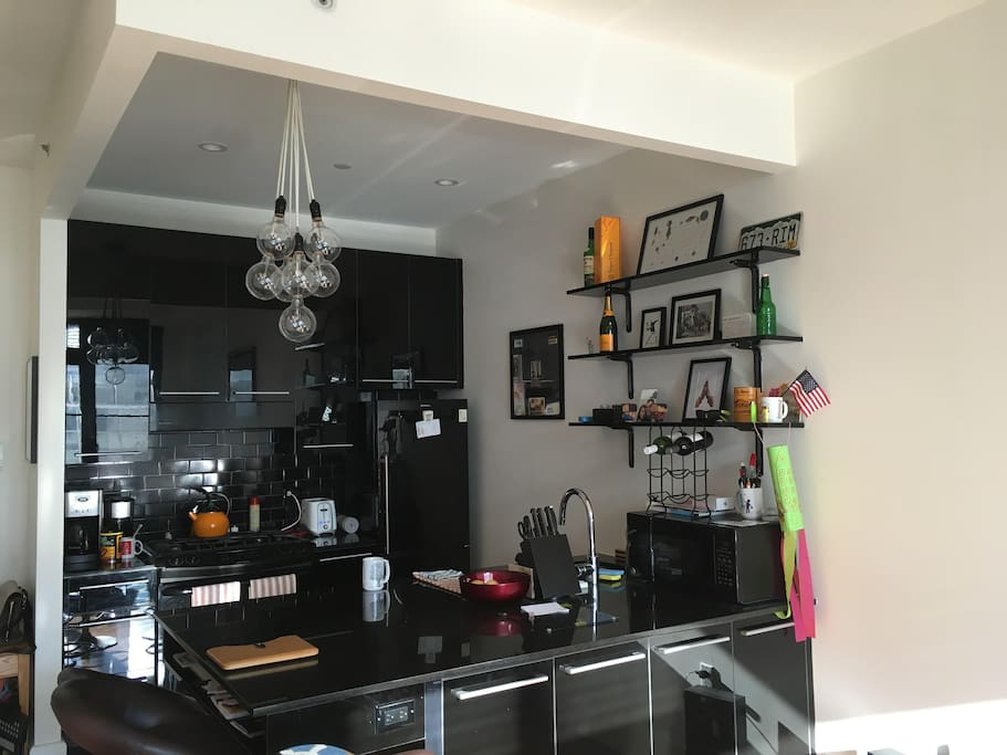 Kitchen set up with all the necessities and large island for preparing and sharing meals