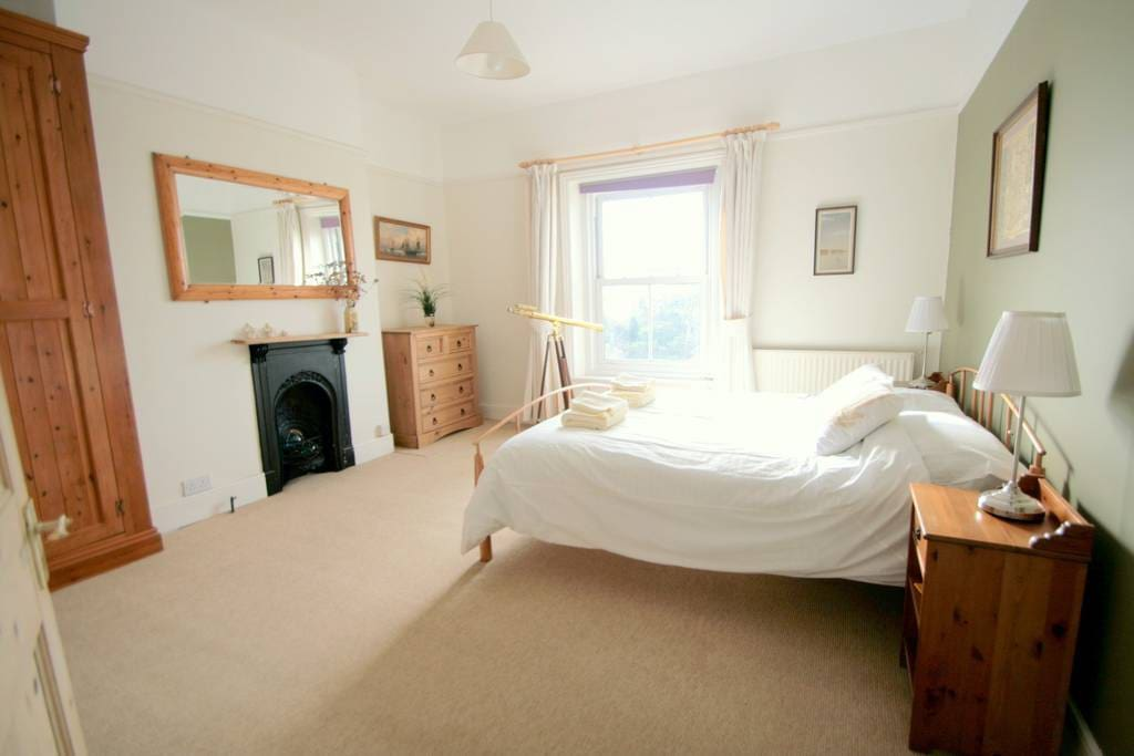 Spacious main bedroom with stunning sea views