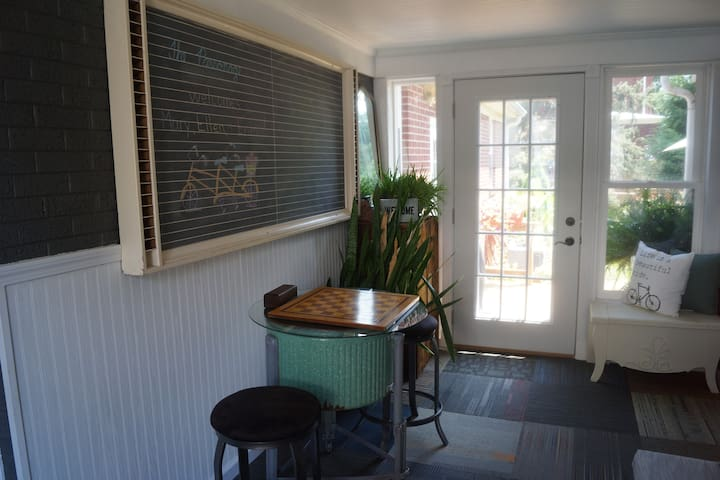Checkers anyone? Sunroom with view to private deck.