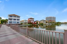 Looking for easy beach access?  Mojo offers a pleasant stroll that is less than three minutes over a private boardwalk across a dune lake to its private, gated, sugar sand beach.