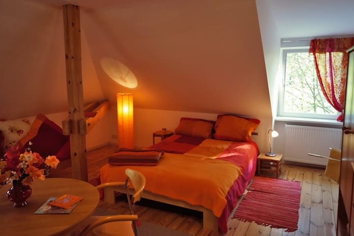 Orange wooden bright bedroom for 1 to 3 guests