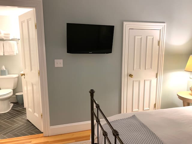 Walk-in closet and Samsung Smart TV with Netflix.