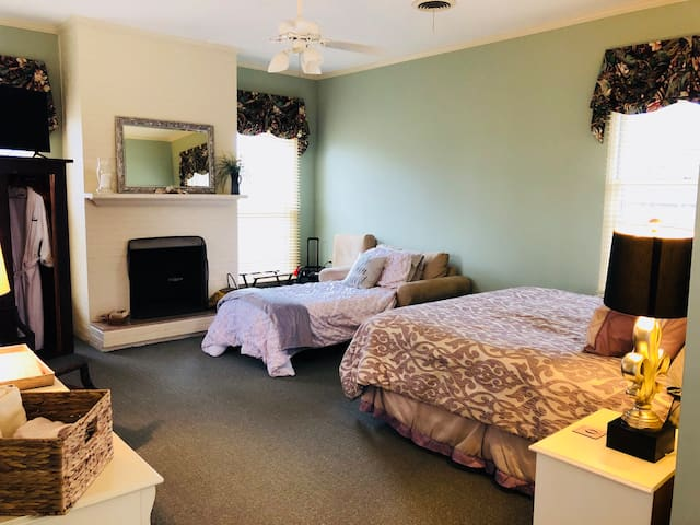 The cottage is one, large open room - except for the private bathroom. The king size bed and sofa bed are in the same room. The cottage is detached from the main house with a private entrance.