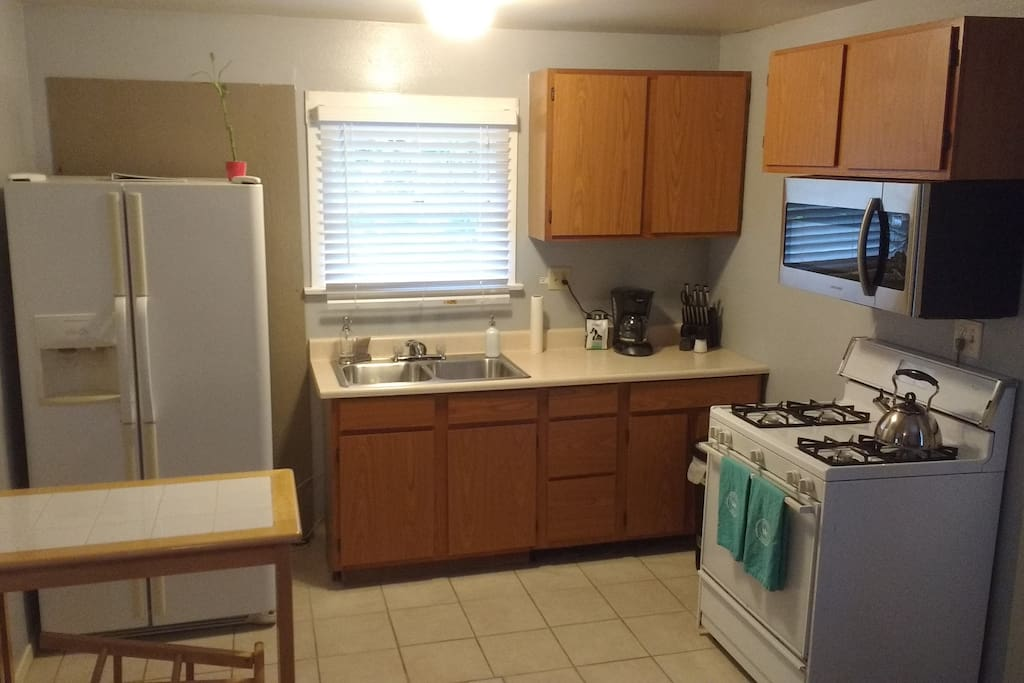 Kitchen includes microwave, range and oven, fridge with water and ice.  Also stocked with pots, pans, dishes, etc.