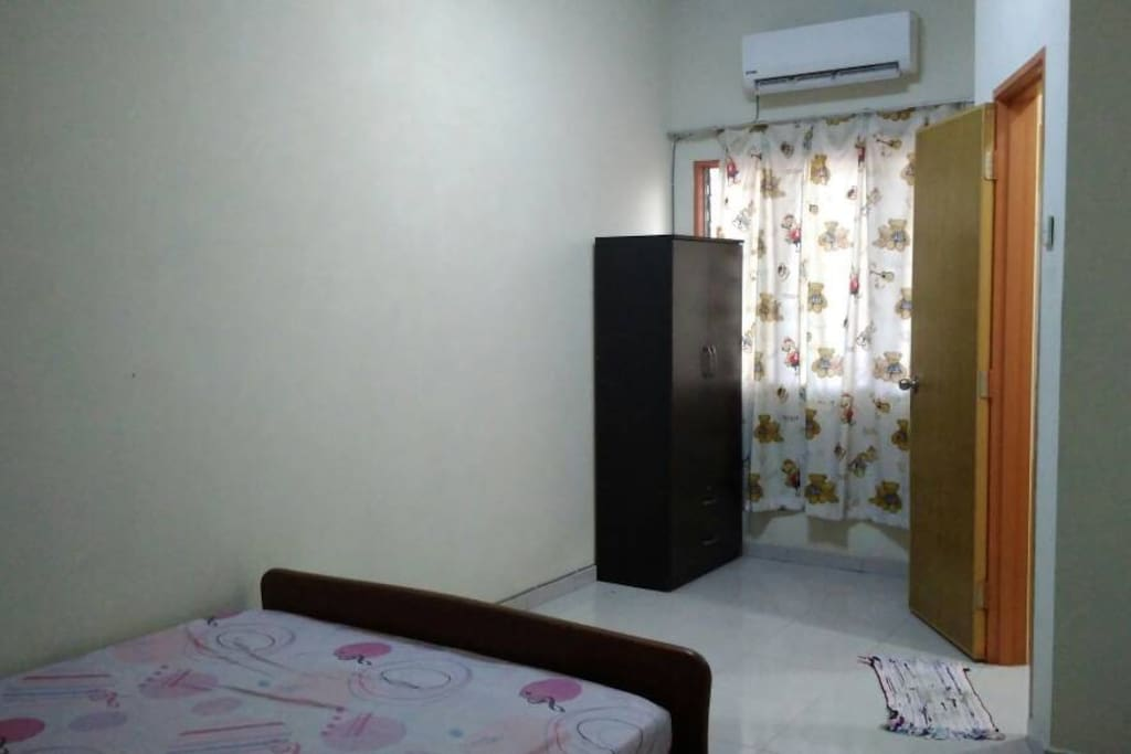 Bedroom 3 (upstairs) with air-conditioner, fan and wardrobe. Shared toilet & shower (+heater) with Bedroom 2. Book this room alone at RM70 (USD18)